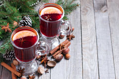 Christmas mulled wine with fir tree and decor. On wooden table Royalty Free Stock Photography