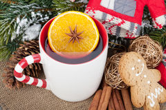Christmas mulled wine with fir tree, gingerbread and decor Royalty Free Stock Image