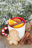 Christmas mulled wine with fir tree, gingerbread and spices Stock Photo