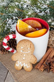 Christmas mulled wine with fir tree, gingerbread and spices Royalty Free Stock Images