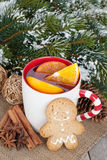 Christmas mulled wine with fir tree, gingerbread and spices Royalty Free Stock Photo