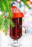Christmas mulled wine in the glass with red hat Stock Photos