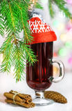 Christmas mulled wine in the glass with red hat Stock Photo