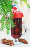 Christmas mulled wine in the glass with red hat Stock Images