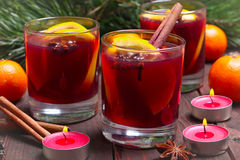 Christmas mulled wine in glasses with orange on wooden table, close-up Royalty Free Stock Photo
