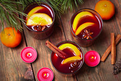 Christmas mulled wine in glasses with orange on wooden table, close-up Royalty Free Stock Photography