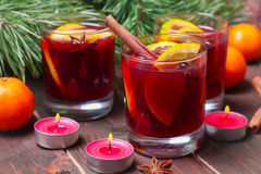 Christmas mulled wine in glasses with orange on wooden table, close-up Stock Photo
