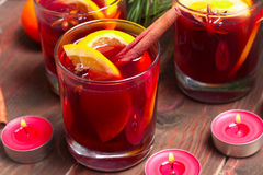 Christmas mulled wine in glasses with orange on wooden table, close-up Stock Photos
