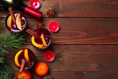 Christmas mulled wine in glasses with orange on wooden table, close-up Royalty Free Stock Images