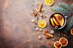 Christmas mulled wine or gluhwein with spices and orange slices on rustic table top view. Traditional drink on winter holiday. Copy space for recipe stock images