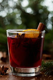 Christmas mulled wine or gluhwein with spices and orange slices on rustic table, traditional drink on winter holiday, magic light Royalty Free Stock Image