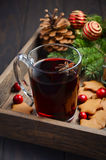 Christmas mulled wine. Holiday concept decorated with Fir branches, Gingerbread Cookies and Cranberries. Royalty Free Stock Photography