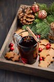 Christmas mulled wine. Holiday concept decorated with Fir branches, Gingerbread Cookies and Cranberries. Royalty Free Stock Images