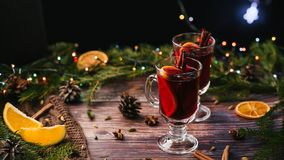 Christmas mulled wine with orange, spices on a wooden table stock images