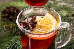 Christmas mulled wine with orange and christmas tree. Winter tradition drink. Close up Stock Images