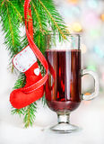 Christmas mulled wine and red sock on fir branch Royalty Free Stock Images