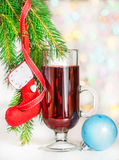 Christmas mulled wine and red sock on fir branch Stock Image
