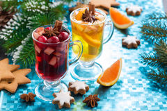 Christmas mulled wine and spiced apple cider on blue background Royalty Free Stock Photos