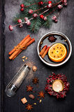 Christmas mulled wine with spices on black slate chalkboard Royalty Free Stock Photos