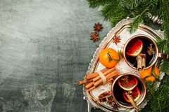 Christmas mulled wine. With spices in copper cups on dark background. Top view with copy space stock photos
