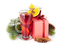 Christmas mulled wine with spices, gift box and snowy fir tree Stock Image