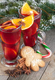 Christmas mulled wine with spices, gingerbread and snowy fir tre Royalty Free Stock Photo