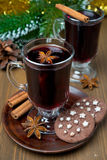 Christmas mulled wine with spices in glass and chocolate cookies Royalty Free Stock Photography