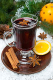 Christmas mulled wine with spices in glass, vertical Stock Image