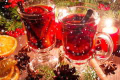 Christmas mulled wine with spices and orange in the candle light. With snow texture. festive romantic drinks background Stock Image