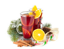 Christmas mulled wine with spices and snowy fir tree Stock Images
