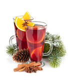 Christmas mulled wine with spices and snowy fir tree Stock Photo