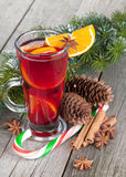 Christmas mulled wine with spices and snowy fir tree Royalty Free Stock Image