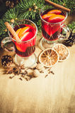 Christmas Mulled Wine, Spices and Xmas Tree Branches. Vintage Toned. Royalty Free Stock Photo