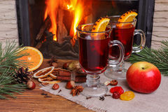 Christmas mulled wine - two glasses on the background of a burni Stock Images