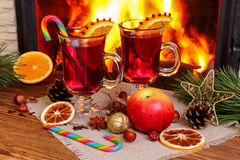 Christmas mulled wine - two glasses on the background of a burni Stock Image