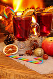 Christmas mulled wine - two glasses on the background of a burni Stock Photos
