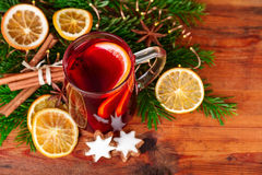 Christmas mulled wine with winter spices on dark wood. Top view royalty free stock photography