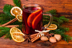 Christmas mulled wine with winter spices on dark wooden background Stock Photos