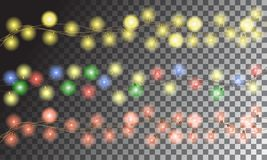 Christmas multicolored glowing garlands on a transparent background Royalty Free Stock Photos