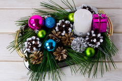 Christmas multicolored ornaments and candle centerpiece Stock Photo