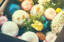Free Christmas Multicolored Toys, Textured Balls Lie In An Open Box, Effect Of The Instagram Royalty Free Stock Photo - 100635185