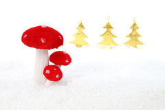 Christmas mushroom in forest scene. Winter scene with red and golden Christmas decorations Stock Photos