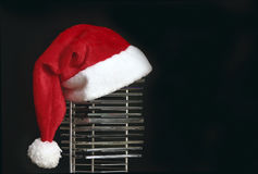 Christmas music. Santa hat on compact disc stand Royalty Free Stock Image
