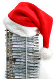 Christmas music. Santa hat on compact disc stand Stock Image