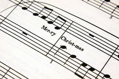Christmas Music. Merry Christmas text on a sheet of music Royalty Free Stock Photography