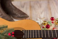 Christmas music background with acoustic guitar and holiday decoration. Christmas music background for text with acoustic guitar and holiday decoration stock photo