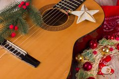 Christmas music background with guitar and holiday decor. Christmas music background with guitar and holiday winter decorations Stock Images