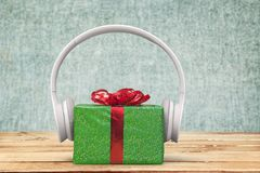 Christmas Music. Gift Birthday Headphones Listening Sound Gift Box royalty free stock image