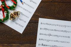Christmas music note paper  with Christmas wreath on wo Stock Image