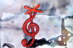 Christmas music note. Picture of a Christmas music note stock photo